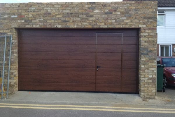 Hormann M-ribbed sectional with wicket door